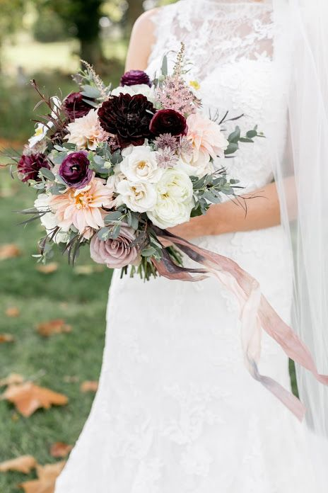 Lush, textural and romantic bridal bouquet featuring cafe au lait dahlias, merlot dahlias,merlot ranunculus, white majolica spray roses, amnesia roses, agonis foliage, light pink astilbe, gunnii eucalyptus and white polo roses with long ombre silk ribbon trailers. Bridal bouquet by Sebesta Design. Photo by Lauri for Emily Wren Photography.