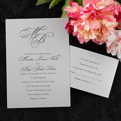A Monogram Is At The Top Of This Silver Shimmer Wedding Invitation
