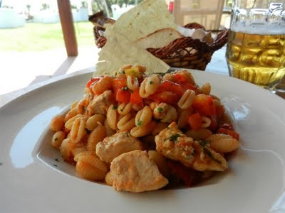 "from Sardinia with love  ""malloreddus"" short tipical pasta with little tomatoes, basil and fresh tuna fish served with tipical thin bread ""carasau"" and local beer Ichnusa  fantastic food and place"