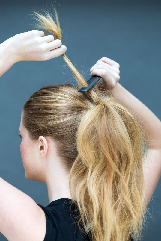 Tease the top ponytail using a comb to create fullness ...