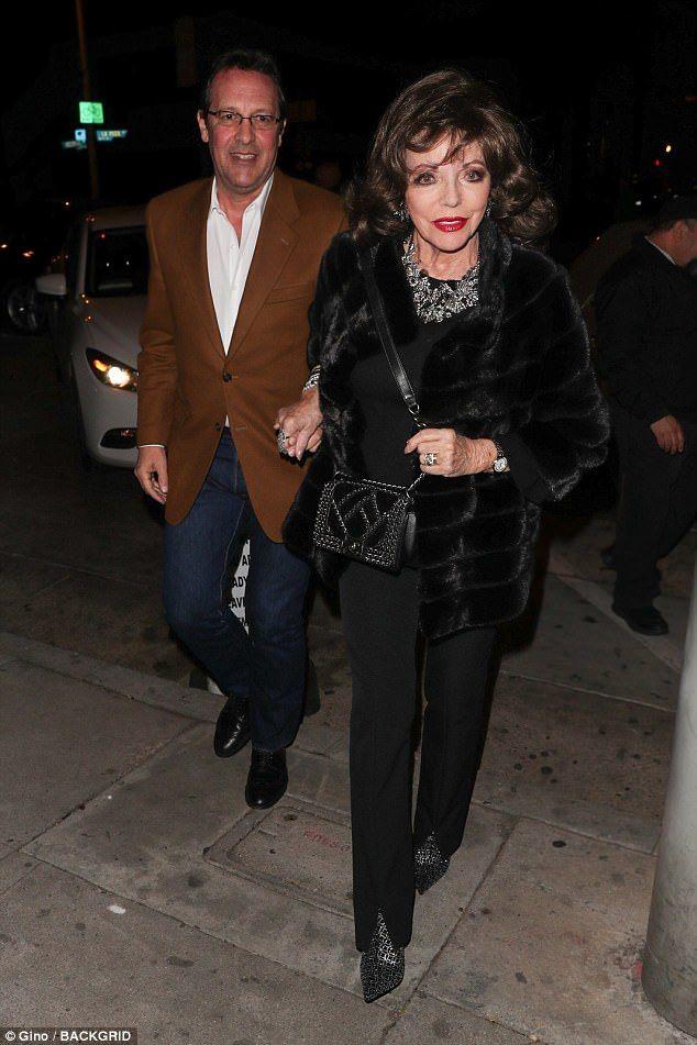 Fur-ever in love! Joan Collins, 84, was exquisite in her elegant jacket as she held hands ...