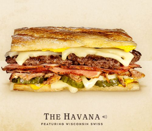 THE HAVANA –The Havana is the first cousin to the well-known Cubano sandwich. Inseparable from childhood to adulthood, the two drifted apart when The Havana gained international notoriety as one of the Cheese & Burger Society's top thirty cheeseburgers. To this very day, the two remain estranged. –THE TOPPINGS & FIXINGS: Wisconsin Swiss Cheese, Beef Patty, Ham, Roasted Pork Shoulder, Pickles, and Yellow Mustard on Pressed French Bread.