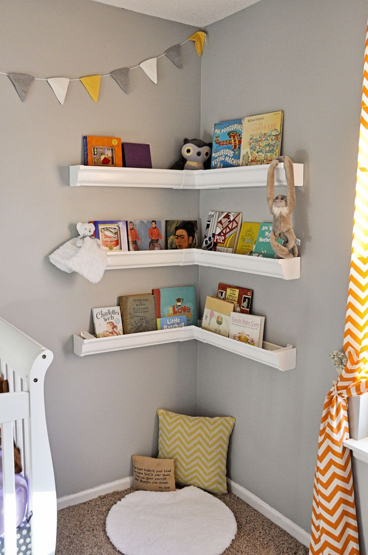 baby boy room themes ideas with bookcase | Rain Gutter Shelves nursery book corner | Boy toddler ...
