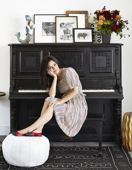 Rachel Bilson - Rachel Bilson at her antique piano topped with a mermaid sculpture and a collection of framed art