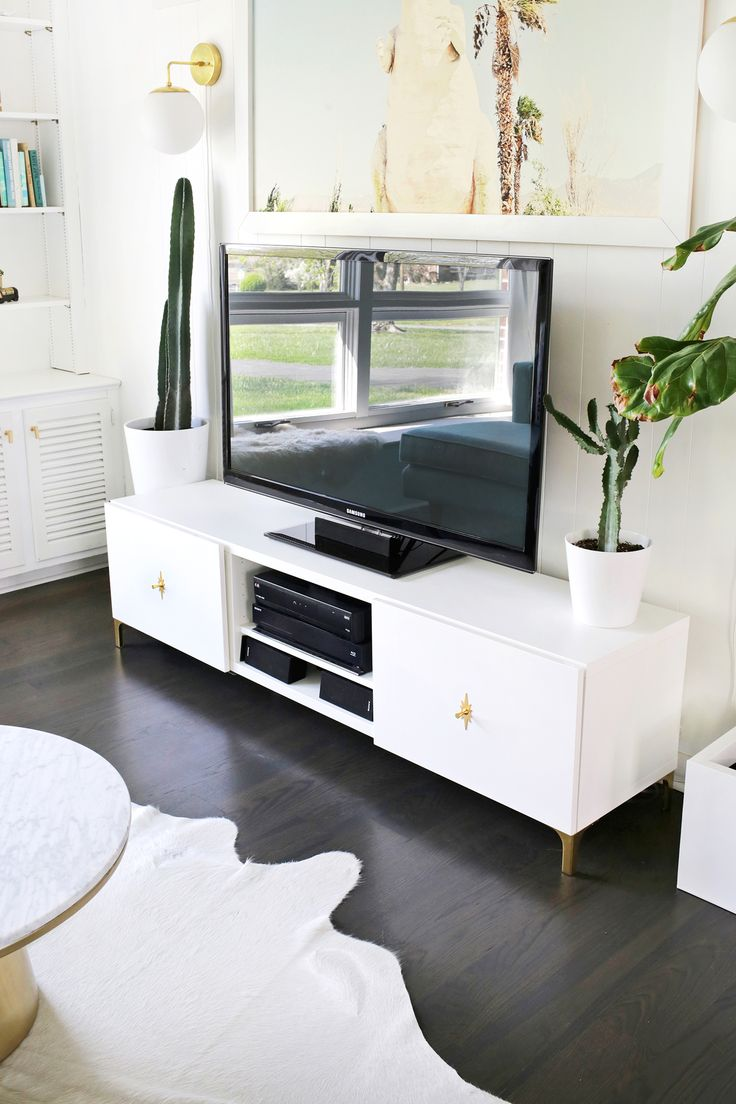 Best 25 white tv stands ideas on pinterest barn door cabinet ikea restyle mid century tv stand a beautiful mess geotapseo Gallery