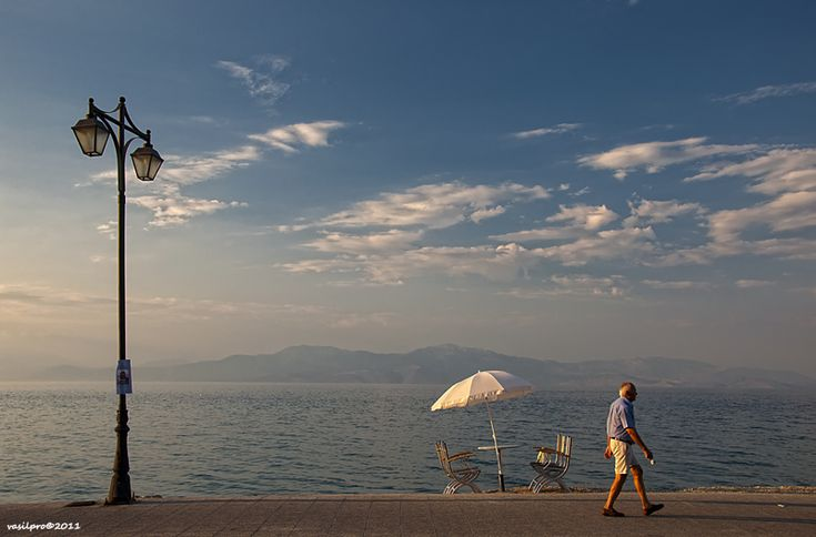 Walking along the coastline by vasilpro