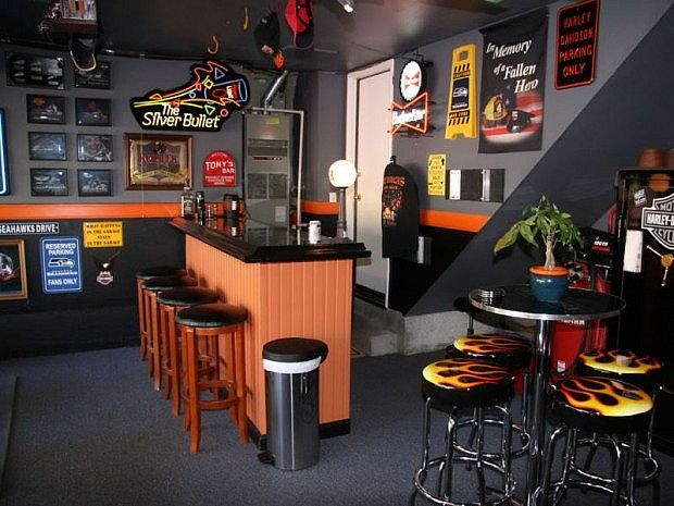 Garage Rec Room/Man Cave. Not exactly my style, but still pretty cool.