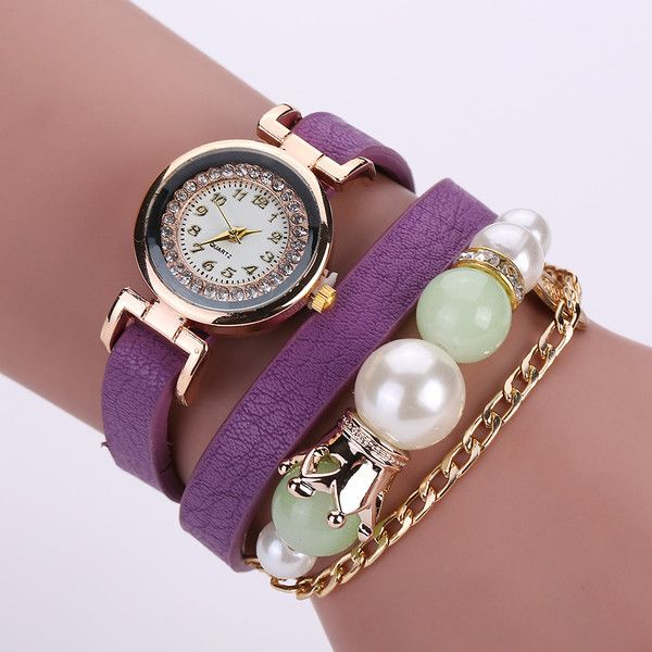 Women's Womens Crown and Pearl PU Leather Wrist Wrap Watch (1455 RSD) ❤ liked on Polyvore featuring jewelry, watches, jewelry & watches, purple, women's watches, pearl watches, pearl charm, purple pearl jewelry, purple watches and crown charm
