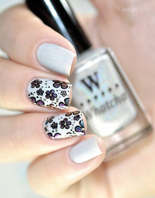 Light gray floral nail art design. Play along with your nails by drawing candid and colorful floral designs on top of a light gray matte background.