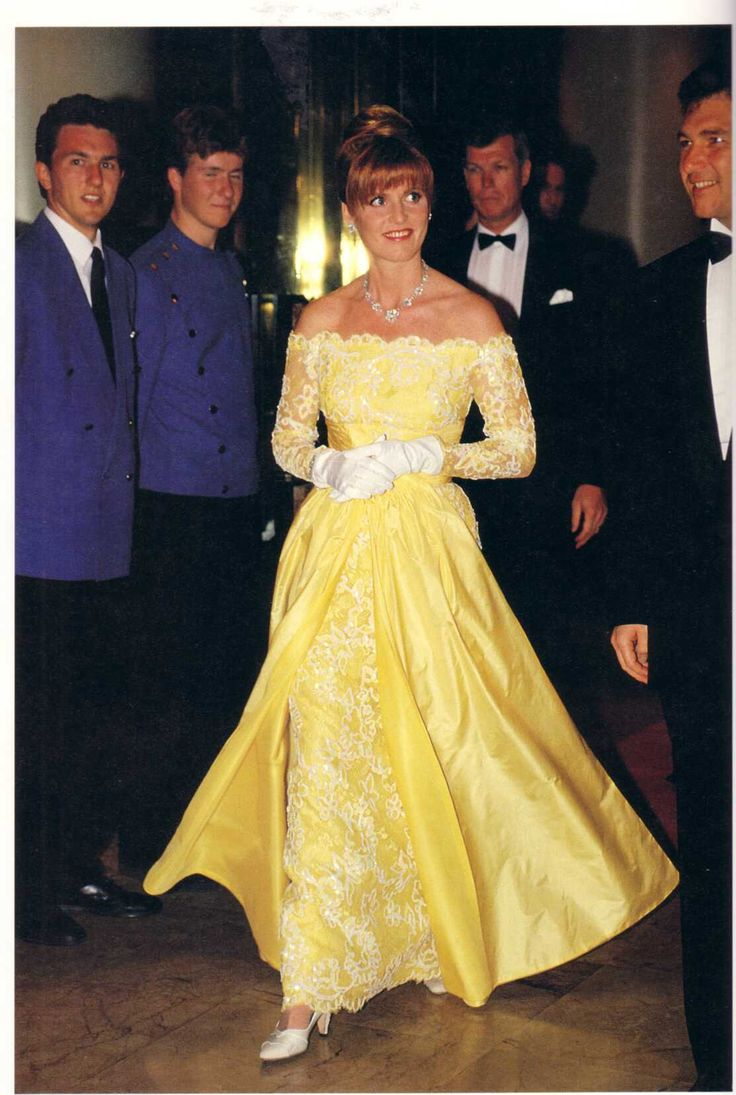 Sarah Ferguson, the Duchess of York, looking lovely in sunny yellow lace.