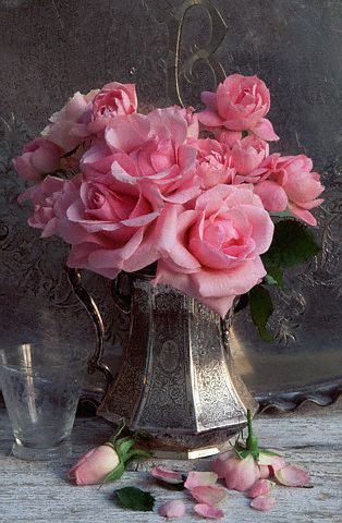 Vintage silver pitchers. (Ana Rosa - http://ana-rosa.tumblr.com/post/43908070761) > I love silver holding fresh flowers!