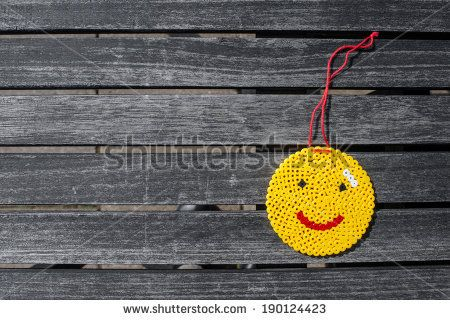 Smiley made out of perls on a table - stock photo