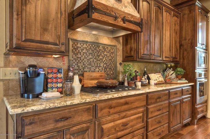 Craftsman Kitchen with Amber Yellow Granite Countertop, Hardwood floors, Custom hood, One-wall, High ceiling, Stone Tile