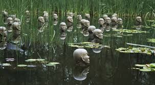 Heads in the water at the Sculpture Garden, National Art Gallery, Canberra