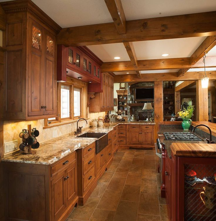 Elegant Mullet Cabinet   Rustic Kitchen Retreat Showcasing Knotty Alder Cabinetry.