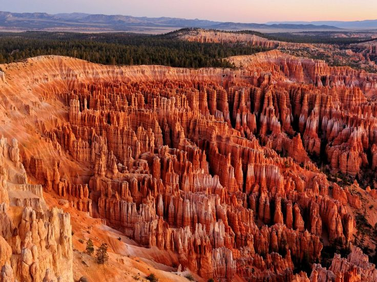 Catch the first rays of light over Bryce Canyon in southwestern Utah.