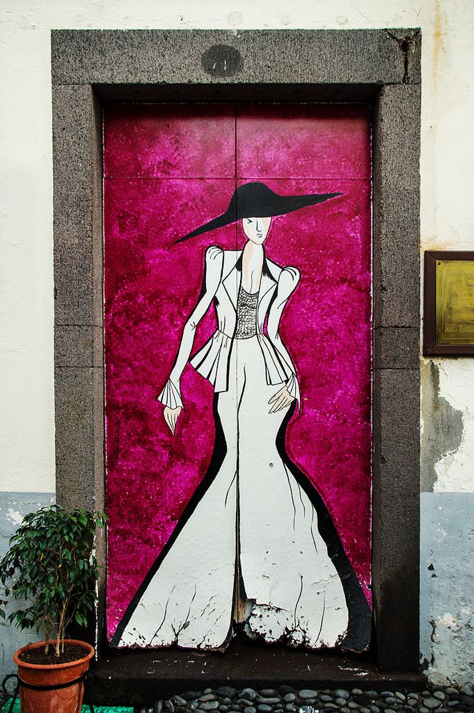Lady painted at a door