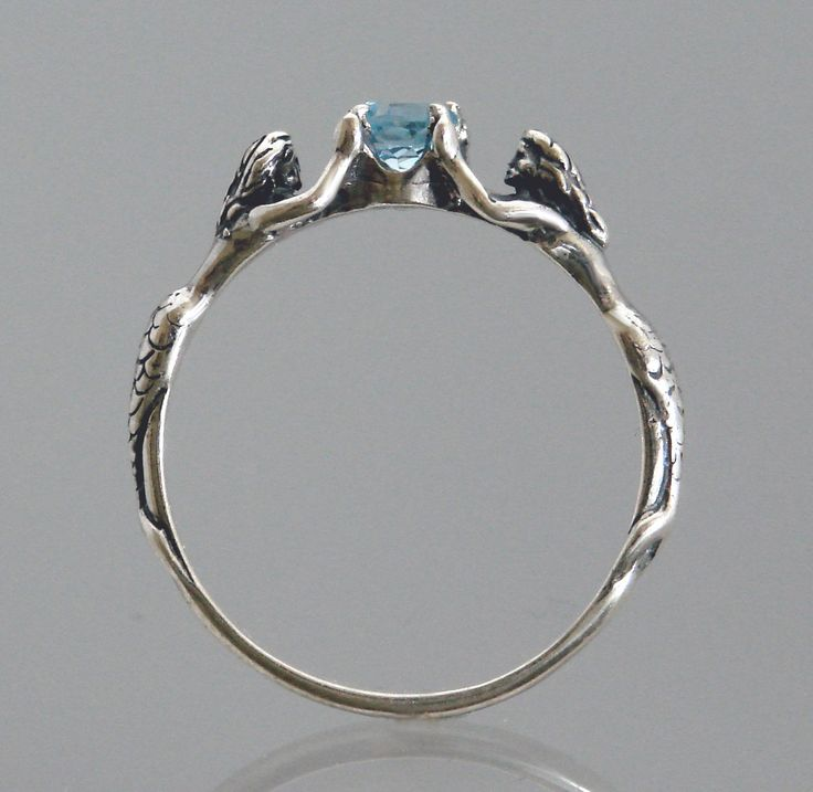 getting this for my birthday! Two Mermaids Ring with Blue Topaz or Other by SheppardHillDesigns. via Etsy.