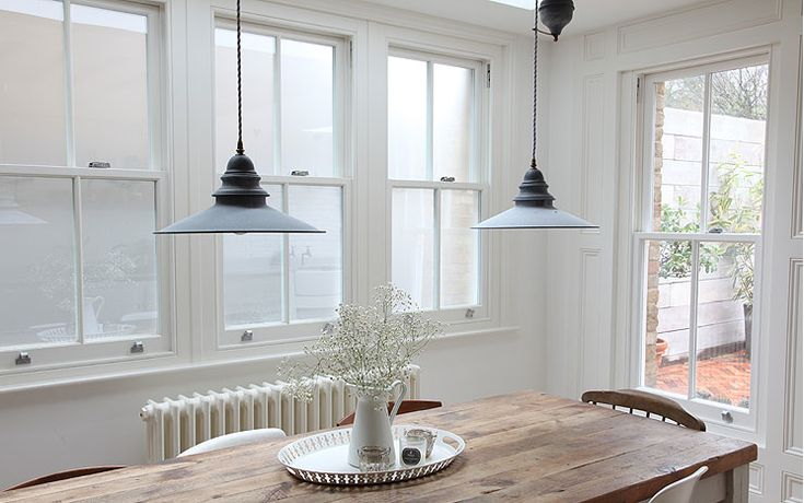 Light fixtures and long rustic table.