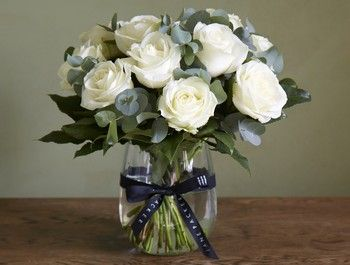 The Jane Packer Foundation bouquet has been created to reflect the purity of design that is a hallmark of Jane Packer's very recognisable philosophy, to let the flowers and foliage speak for themselves, without unnecessary complication or clutter. The use of a single variety of white rose, which Jane adored, partnered with silver green eucalyptus foliage, is a perfect portrayal of Jane's definitive style of stunning simplicity. The bouquet of a dozen white roses is teamed with a unique ...
