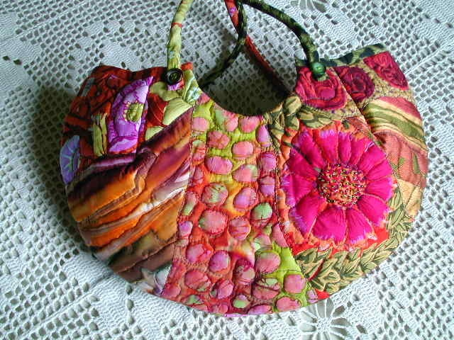 ByHanne  This artist makes some beautiful dyed and quilted items.