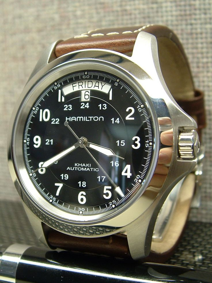 Hamilton Khaki Automatic. Love a man with a good time piece - nothing flashy or showy, but something elegant, sophisticated and timeless. The kind of watch you can imagine him passing on to his son.