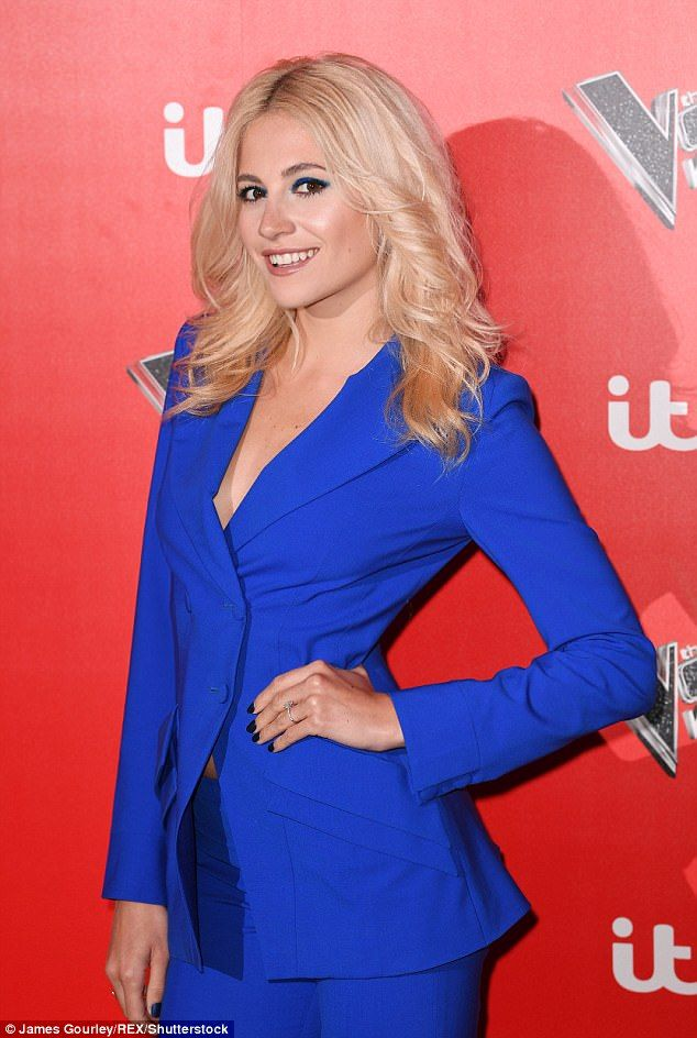 Suits you! The 26-year-old star stole the show in an electric blue suit