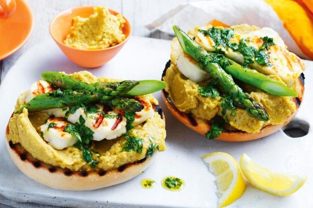 Enjoy fresh bagels topped with a zesty avocado hummus, grilled haloumi ...