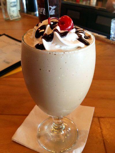 Bushwacker - 1/2 oz Rum, 1/2 oz Vodka, 1/2 oz Baileys, 1/2 oz Kahlua, 1/2 oz Amaretto, 1/2 oz Chocolate Flavored Liqueur, 1/2 oz Frangelico, 1/2 oz Creme de Coconut, 1 cup Crushed Ice, 3 dashes Nutmeg, 1 tbs Whipped Cream, 1 Cherry