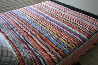 Simply beautiful-I love the way the stripes change direction around the bottom of the bed, like a skirt.
