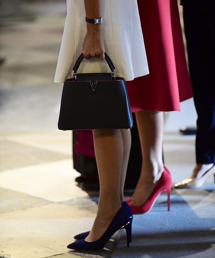 Brigitte carried a Louis Vuitton bag, and while Melania sported red pumps to match her skirt suit, France's first lady opted for blue suede pumps with gold detailing
