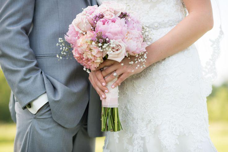 pink wedding bouquet + vintage wedding bands