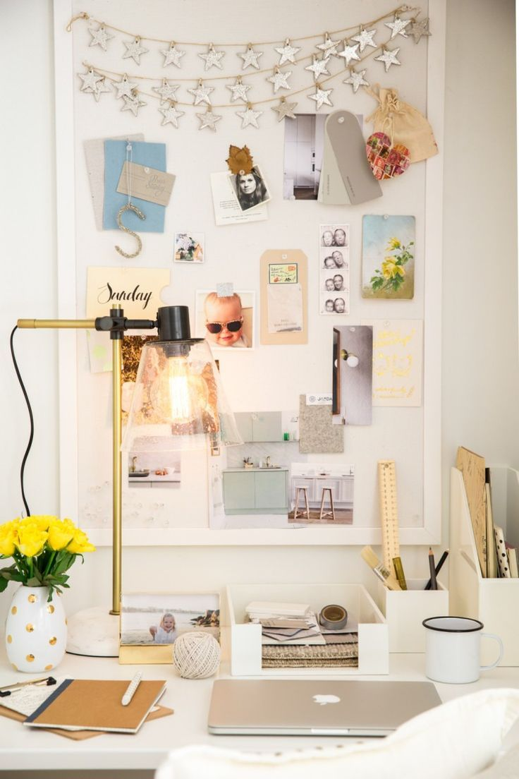 Gold and white desk space and moodboard.