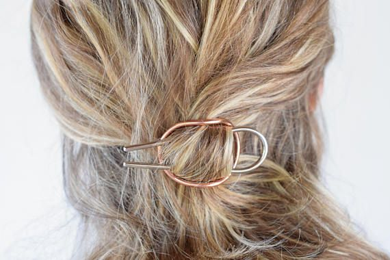 A handmade curved german silver and copper hair barrette . Due to its design it holds hair super tight and it is ideal for both short and long hair! German silver is not silver , its an alloy of copper, zinc and nickel and has silver-white color. Made from raw german silver , soldered