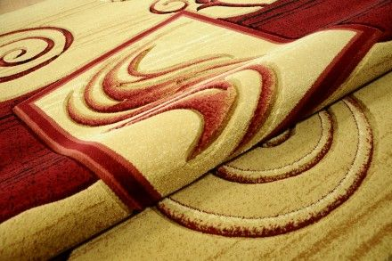 Dywan tradycyjny Bumerangi na środku czerwień. Dywan ręcznie wycinany wykonany technologią Heat Set