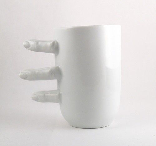 Porcelain Cup with Fingers. This would be a little creepy for me, holding on to fingers while drinking from this cup. :)