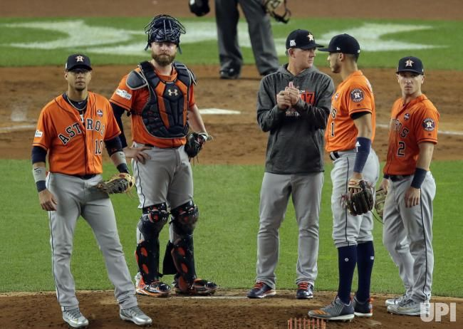 Houston Astros first baseman Yuli Gurriel, catcher Brian McCann, manager A.J. Hinch, shortstop Carlos Correa and third baseman Alex Bregman…