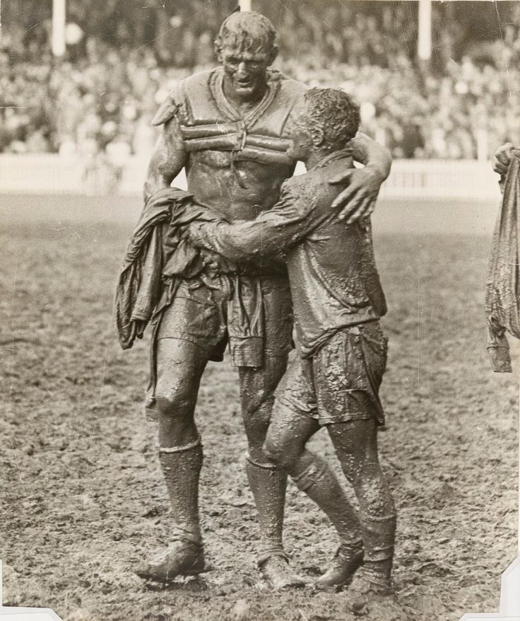 Opposing team captains Norm Provan and Arthur Summons embrace after the 1963 Australian rugby league final.