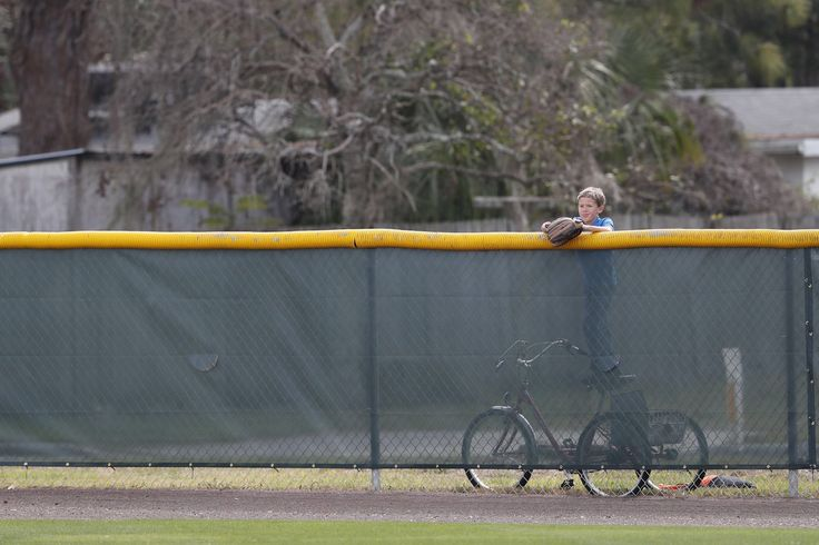 """""""Taking a break from the sandlot to watch the big kids play. #OrangeSpring 🚲⚾️🌴"""""""
