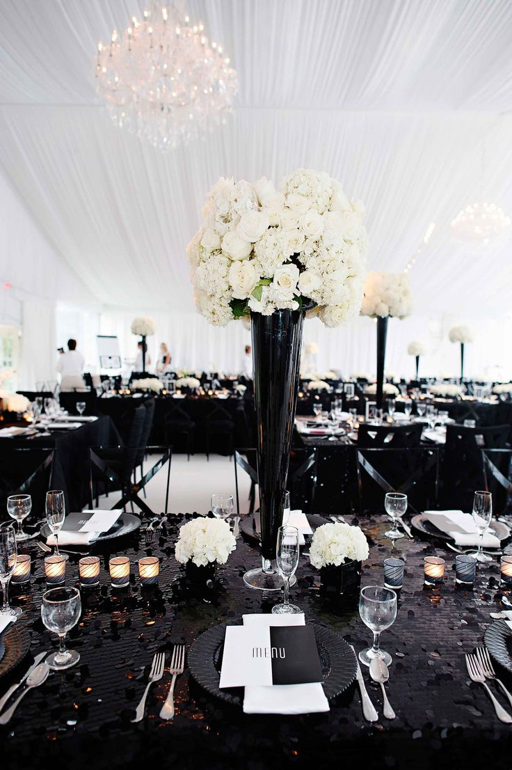 Tall, Black & White Centerpiece on Sequined Linen | Photography: Kortnee Kate. Read More: http://www.insideweddings.com/weddings/black-and-white-modern-wedding-with-unique-details-in-cincinnati/698/