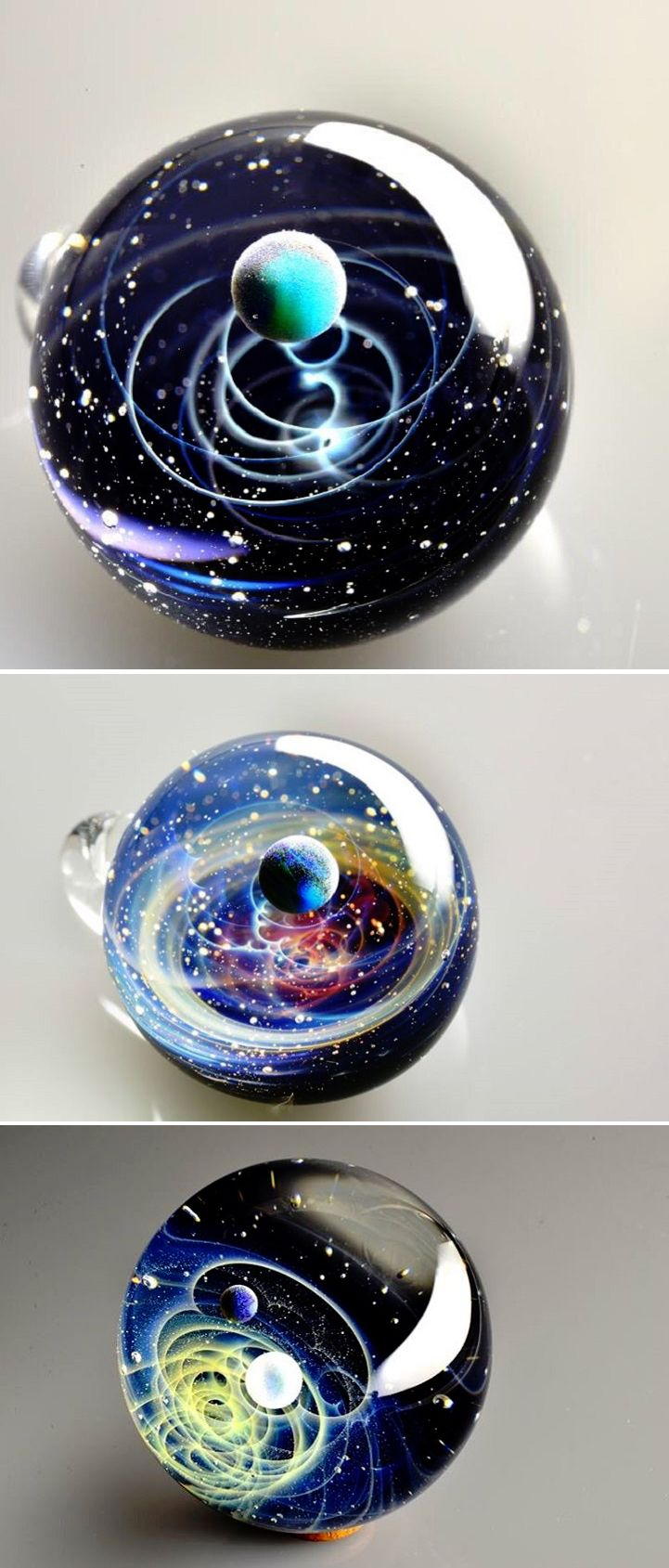 Crafted by Japanese glass artist Satoshi Tomizu. Each of these pendants look like an entire galaxy captured within a bubble.