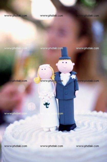 http://www.photaki.com/picture-marzipan-couple-on-wedding-cake_1323410.htm