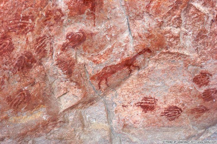 Prints inside Elands Bay Cave at Baboon Mountain (Bobbejaanberg). South Africa.