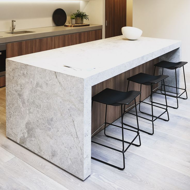 Natural limestone kitchen island with undercut for bar chairs. Love the shadow gap.  St Boulevard  - Architectural & Interior Design by Elenberg Fraser.