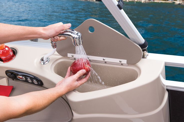 Starboard aft fully molded fiberglass refreshment center w/sink, pull-out sprayer, 13.5-gal. on-demand fresh water tank, food-prep area, drink holders & courtesy light http://www.exclusiveautomarine.com/product/party-barge-254-xp3