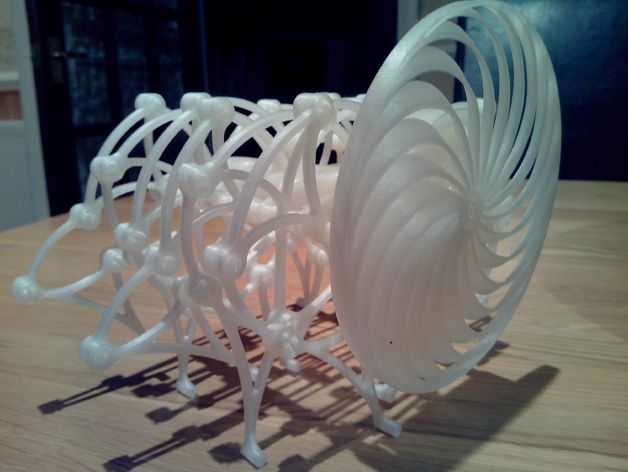 Based upon the famous walking Strandbeest from Theo Jansen ( http://www.strandbeest.com ). This is a modular clip together system that is FDM printer friendly. No support required.