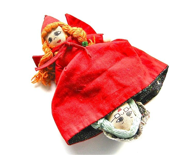 3 dolls in one... Red Riding Hood, Granny and if you turn granny's cap over granny's face - the back of her head is THE BIG BAD WOLF!