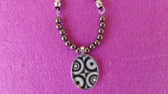 Crazy Circles decoupage necklace. Oval silver by ArtisticBreaths.....