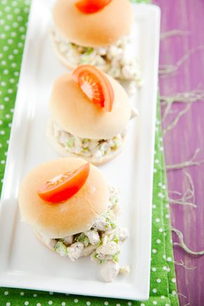 chicken salad sliders with mini toothpick pennants in them