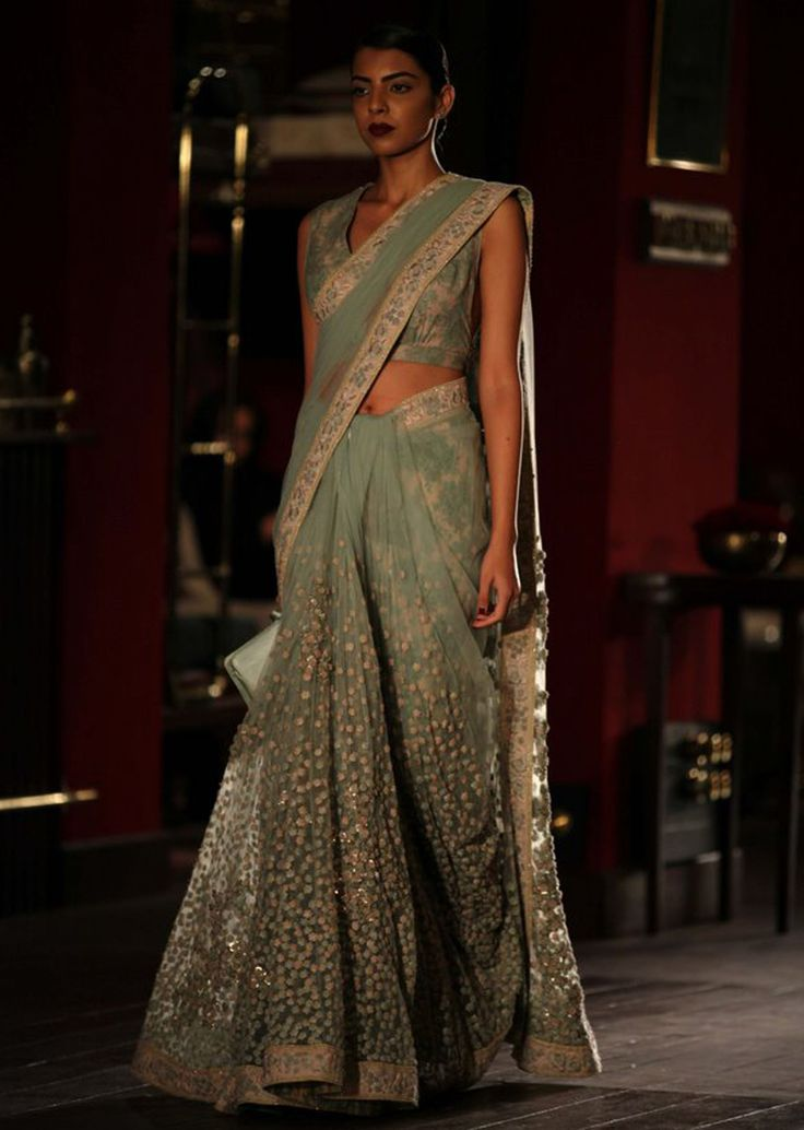 Modelin green net saree for sabyasachi collection during Indian couture week July 2014